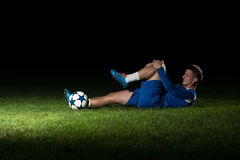 Injured Football Player Lying On The Ground Royalty Free Stock Photo