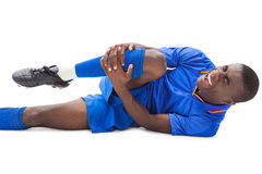 Injured football player lying on the ground Stock Photography