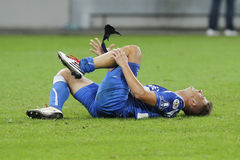 Injured football player. Lying on the football pitch in the match between Dinamo Bucharest and Gloria Bistrita, Romania, League 1 Stock Images