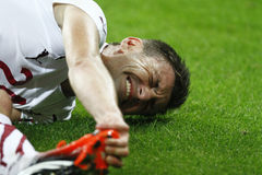 Injured football player. (Romeo Surdu) lying on the football pitch during the match between Dinamo Bucharest and Rapid Bucharest, Romania, League 1 Stock Photo