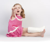 Injured girl crying Stock Images