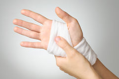 Injured hand with bandage Royalty Free Stock Image