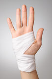 Injured hand with bandage Royalty Free Stock Photography
