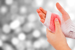 Injured hand of the girl on silver background Stock Image