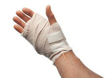 Injured hand, isolated. Injured male hand wrapped with bandage, isolated with clipping path Royalty Free Stock Photography