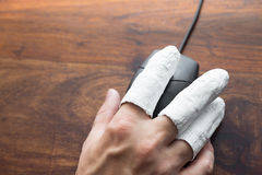 Injured  hand with PC mouse Stock Images