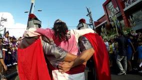 Injured Jesus Christ carried by Roman Soldiers. San Pablo City, Laguna, Philippines - April 1, 2016: Injured Jesus Christ carried by Roman Soldiers publicly stock video footage