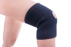 Injured knee in orthopedic bandage. Royalty Free Stock Photos