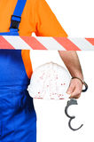 Injured laborer at accident scene hard hat with blood on white background Stock Photos