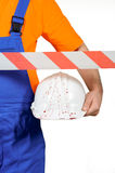 Injured laborer at construction yard with bloody helmet on white background. Injured laborer at accident scene hard hat with blood on white background Royalty Free Stock Images