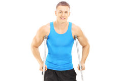 Injured male athlete with crutches Royalty Free Stock Photo