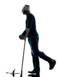 Injured man careless walking with crutches silhouette Stock Photo