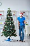 The injured man celebrating christmas at home Stock Photos