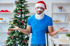 The injured man celebrating christmas at home Royalty Free Stock Image