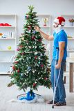 The injured man celebrating christmas at home Royalty Free Stock Photo