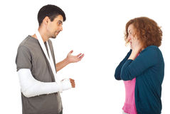 Injured man explain to worried wife. Injured man giving explanations about what happen to his worried surprised wife isolated on white background stock images