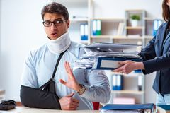 The injured man getting more work from his boss. Injured man getting more work from his boss stock image