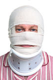 Injured man with a head bandage. Photo of an injured man with a head bandage and Cervical neck collar, isolated on a white background stock photos