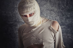 Injured Man with Head Bandages. Injured Mad with Brain Concussion and Wounded Head wearing Medical Bandages Royalty Free Stock Image