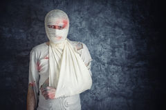 Injured Man with Head Bandages Stock Images