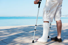 An Injured man with a plaster. On the beach Stock Images