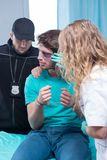 Injured man with policeman and doctor Stock Images