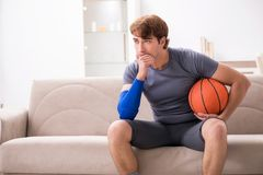 The injured man recovering at home from sports injury. Injured man recovering at home from sports injury stock images