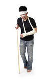 Injured man walk with stick full body. Full body portrait of an upset injured man walking with disability stick, isolated on white background royalty free stock photography