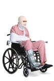 Injured man in a wheelchair side view Royalty Free Stock Image