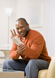Injured man with wrist splint gesturing. The peace symbol Royalty Free Stock Photo