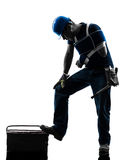 Injured manual worker man with injury brace despair silhouette stock photos