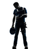 Injured manual worker man with injury brace despair silhouette Stock Photography