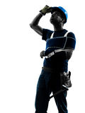 Injured manual worker man with injury brace despair silhouette Stock Image