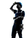 Injured manual worker man with injury brace despair silhouette stock image