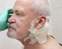 Injured old man. Injured face old man isolated on white stock images