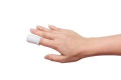 Injured painful finger with white gauze bandage. isolated on whi Stock Photo