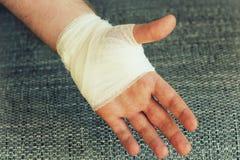 Injured painful hand with white gauze bandage.  Royalty Free Stock Photos