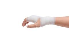 Injured painful hand with white gauze bandage. isolated on white Stock Images