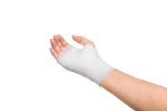 Injured painful hand with white gauze bandage. isolated on white Stock Photos