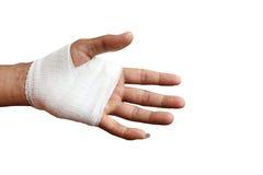 Injured painful hand with white gauze bandage. isolated on white. Close up Injured painful hand with white gauze bandage. isolated on white Royalty Free Stock Images