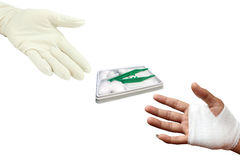 Injured painful hand with white gauze bandage Royalty Free Stock Image