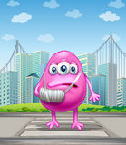 An injured pink monster crossing the street Stock Images