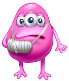 An injured pink monster Royalty Free Stock Images