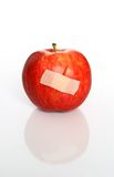 Injured red apple Stock Image
