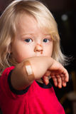 Injured sad boy with band aid on elbow Royalty Free Stock Photo