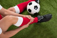 Injured soccer player. Close-up Of Injured Soccer Player On Field Royalty Free Stock Photo