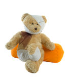 Injured Teddy Bear. With bandages on head and leg isolated over white background Royalty Free Stock Photos