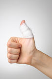 Injured thumb with bandage Royalty Free Stock Photography