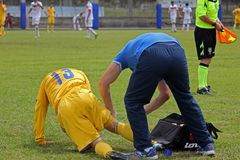 Injured ukrainian player. A injured player with the doctor in the deaf world cup match ukraine vs iran played at eboli in italy royalty free stock image