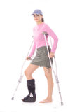 Injured woman with crutches Royalty Free Stock Image